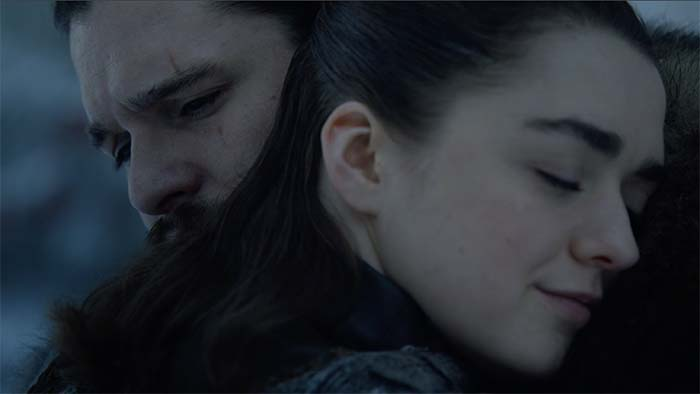 Arya and Jon hug