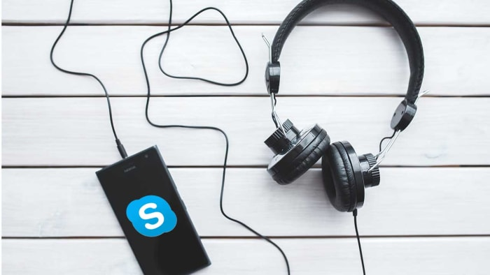 skype on a mobile connected to headphones